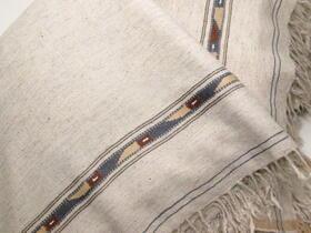 Cream colour patu with tribal pattern